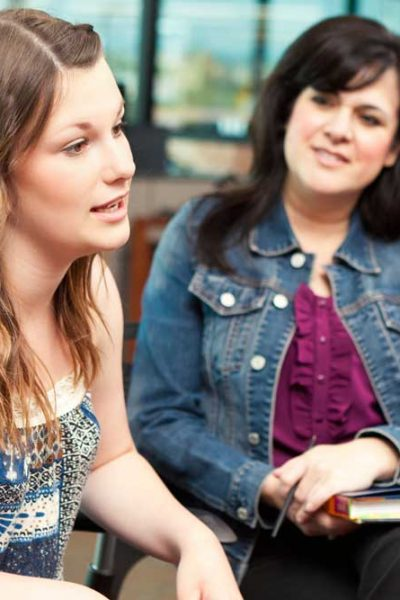woman-speaking-in-group